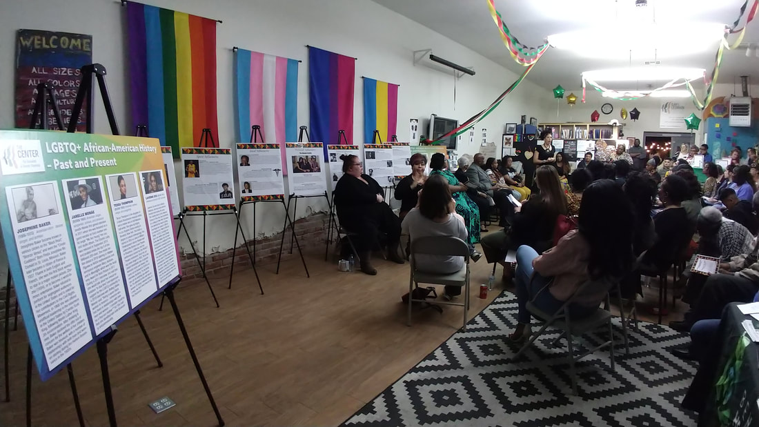The Center with a large audience listening to presentations about LGBTQ and African American/Black history